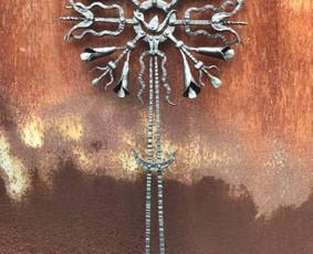 kalviška saulutė kryžius