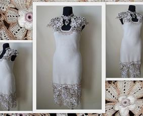 Suknelė trumpomis rankovėmis nerta kabliuku iš 100 % medvilninių siūlų. Nerta lygiuoju raštu su airiškais nėrinių motyvais.