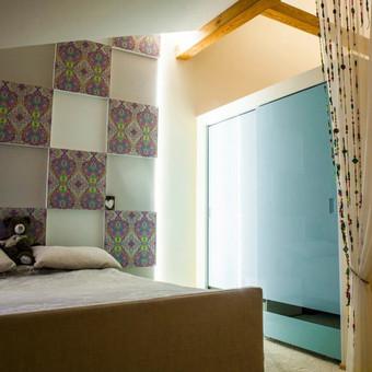 Miegamasis mansardoje