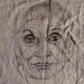 Portretas pieštas ant audinio.