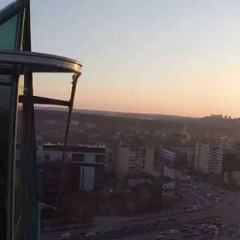 Saulei leidžiantis Vilniuje. NT fotografavimas ir filmavimas iš drono, nekilnojimo turto fotografvimas ir filmavimas dronu